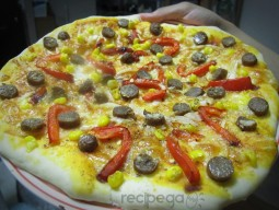 Pizza with beef sausage