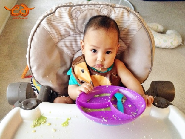messy baby eating solid foods